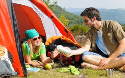 Camping young couple with tent summer countryside